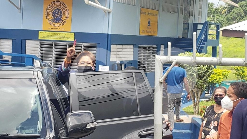 Pictured: UNC leader Kamla Persad-Bissessar holds up her stained index finger after casting her ballot at the Hermitage Presbyterian School. Photo by Darlisa Ghouralal.