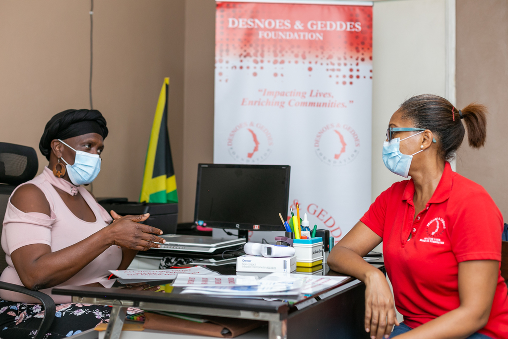 Angela Gordon-Black (left), Principal of Callaloo Mews Basic School, in discussion with Stephannie Coy, Project Manager at the Desnoes and Geddes Foundation.