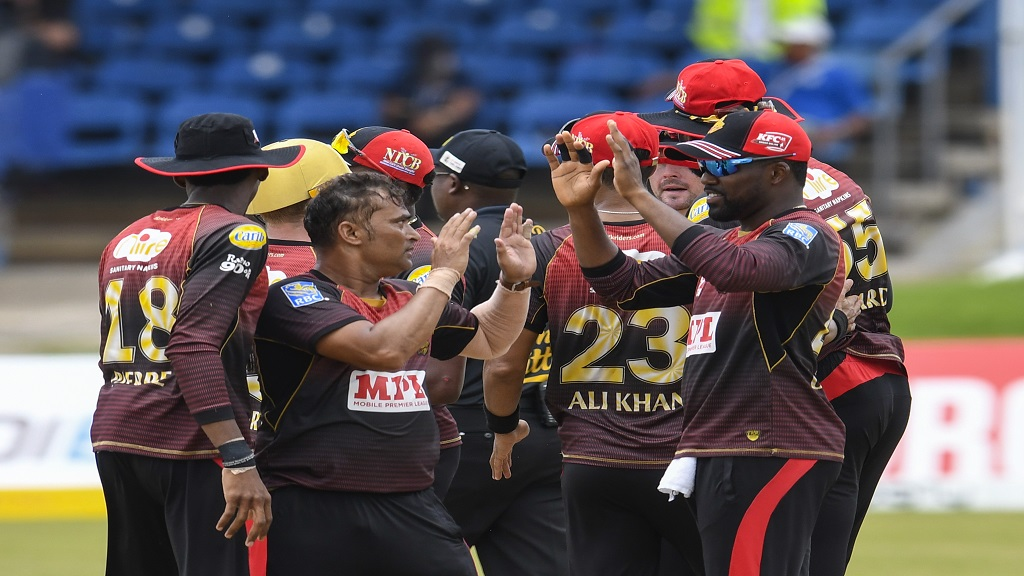 Pravin Tambe (left) and Darren Bravo (right) of Trinbago Knight Riders celebrate the dismissal of Najibullah Zadran of St Lucia Zouks during Match No. 13 of the Hero Caribbean Premier League at Queen's Park Oval in Port of Spain, Trinidad and Tobago on Wednesday, August 26, 2020 (Photo by Randy Brooks - CPL T20/CPL T20 via Getty Images).