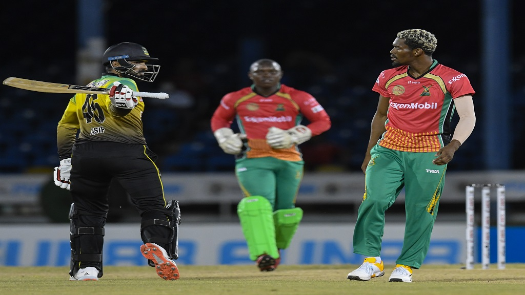 Asif Ali (left) of Jamaica Tallawahs reacts after his dismissal by Keemo Paul (right) of Guyana Amazon Warriors during the 12th match of the Hero Caribbean Premier League at Queen's Park Oval in Port-of-Spain, Trinidad and Tobago on Tuesday, August 25, 2020. (Photo by Randy Brooks - CPL T20/CPL T20 via Getty Images).