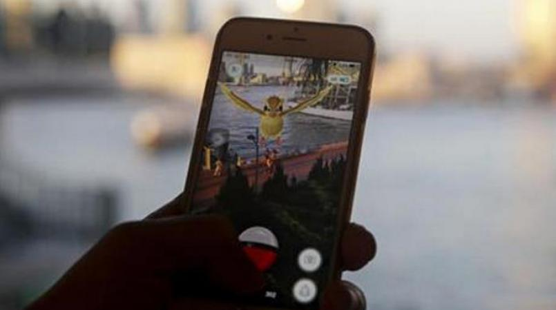 Someone playing Pokemon Go on a smartphone (FILE)