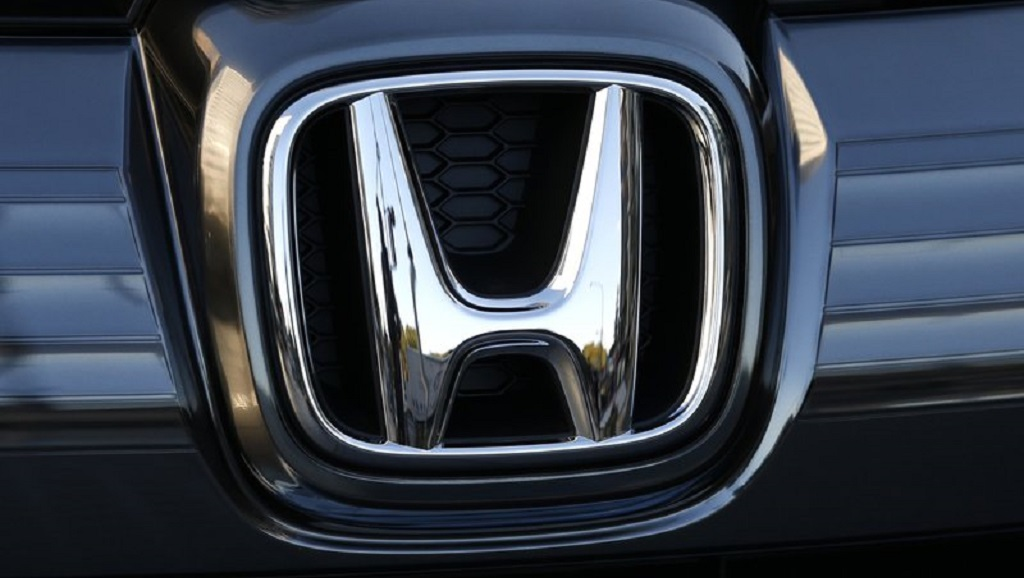FILE - In this Jan. 11, 2016, file photo, the logo of Honda Motor Co. is seen on a Honda vehicle at the Japanese automaker's headquarters in Tokyo. Honda, on Tuesday, August 4, 2020, is recalling over 1.6 million minivans and SUVs in the US to fix problems that include faulty backup camera displays, malfunctioning dashboard lights and sliding doors that don't latch properly. (AP Photo/Shuji Kajiyama, File)