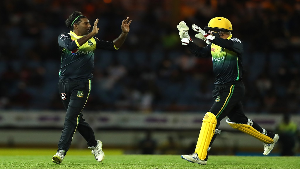 Jamaica Tallawahs' Imran Khan (left) and Glenn Phillips celebrate the fall of a wicket during a Caribbean Premier League match in 2019.