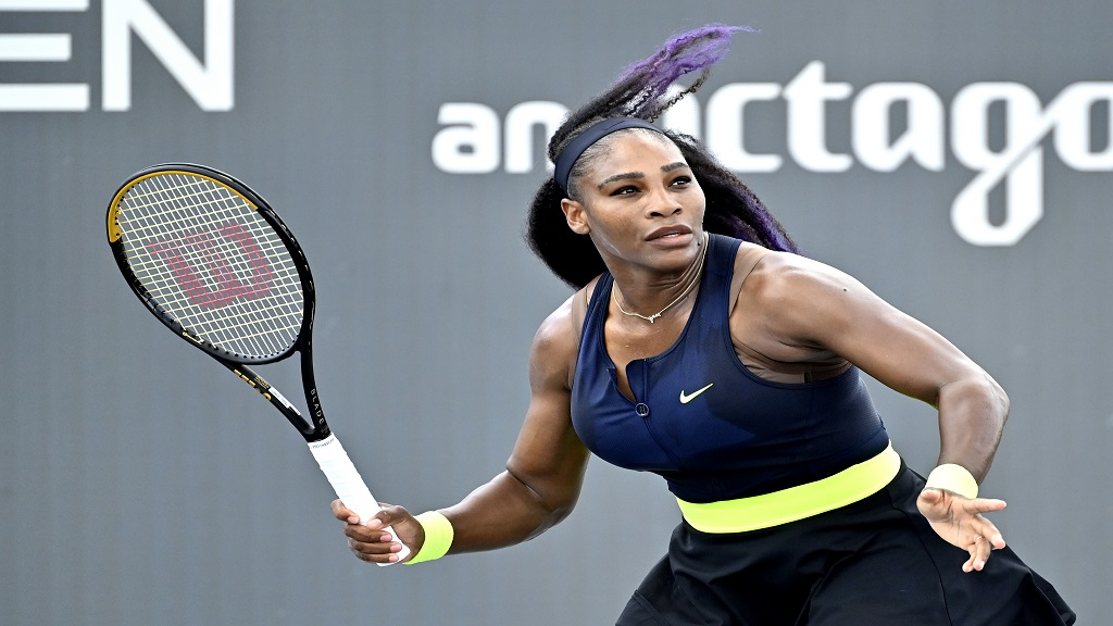 Serena Williams prepares to return a shot to her sister Venus Williams during the WTA tennis tournament in Nicholasville, Ky., Thursday, Aug. 13, 2020. (AP Photo/Timothy D. Easley).