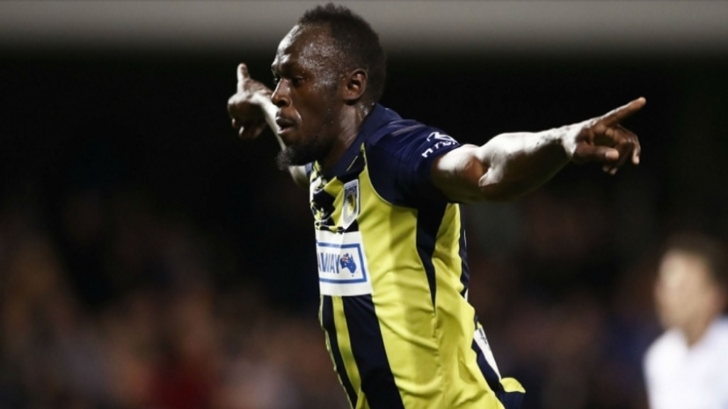 Usain Bolt celebrates scoring a goal during a trial game with Australian A-League outfit, the Central Coast Mariners.