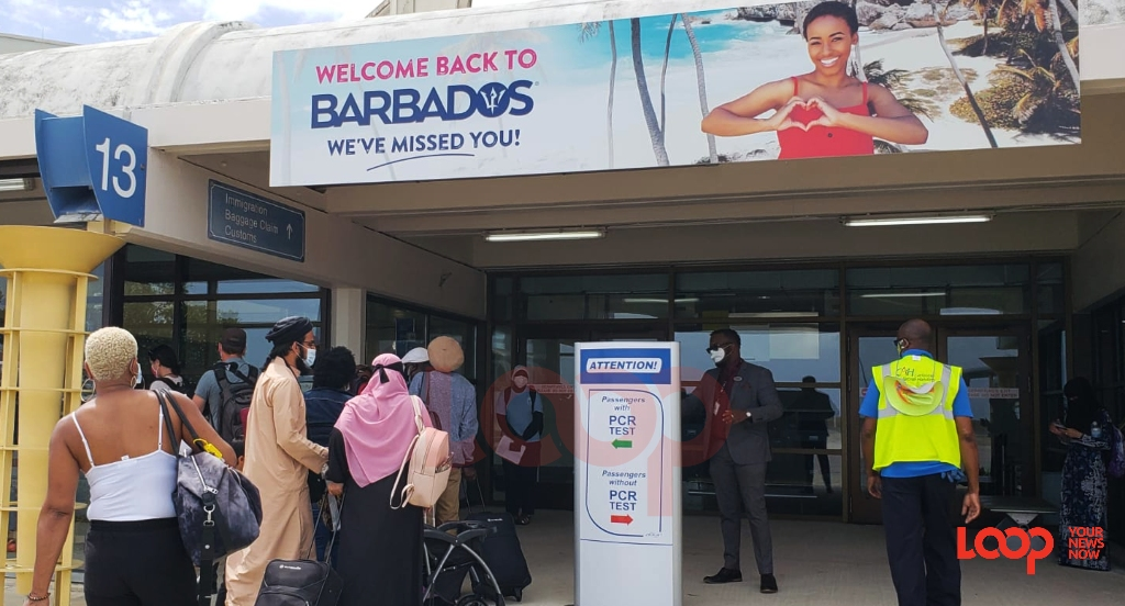 Travellers to Barbados who have pretested and those have no negative test result are separated at the Grantley Adams International Airport.