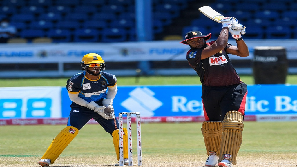 Kieron Pollard (right) of Trinbago Knight Riders hits a six, while Shai Hope (left) of Barbados Tridents watches during the 17th match of the Hero Caribbean Premier League at Queen's Park Oval in Port-of-Spain, Trinidad and Tobago on Saturday, August 29, 2020. (Photo by Randy Brooks - CPL T20/CPL T20 via Getty Images).