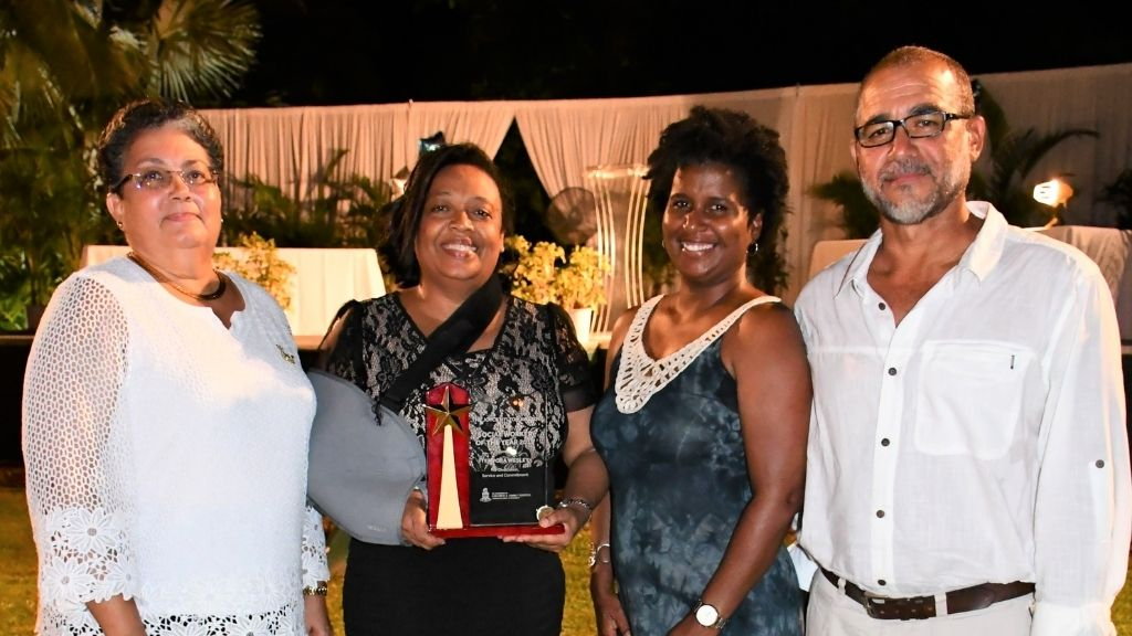 Mike Simmons estate executor Elva Smith, Social Worker of the Year awardee Tempora Wesley, Sandra Simmons-Francis and husband Joel Francis at the DCFS Recognition Awards Dinner on Saturday, 26 September.