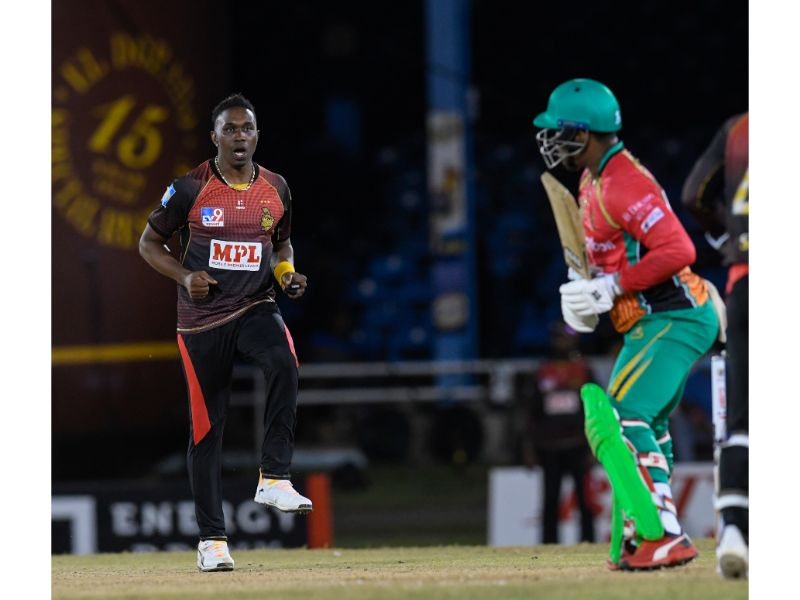 Trinbago Knight Riders bowler Dwayne Bravo dances after dismissing Guyana Amazon Warriors batsman Shimron Heymyer  on 27th August 2020 at the Queen's Park Oval, in Game 16 of the 2020 Hero Caribbean Premier League.   (Photo by Randy Brooks - CPL T20/Getty Images)