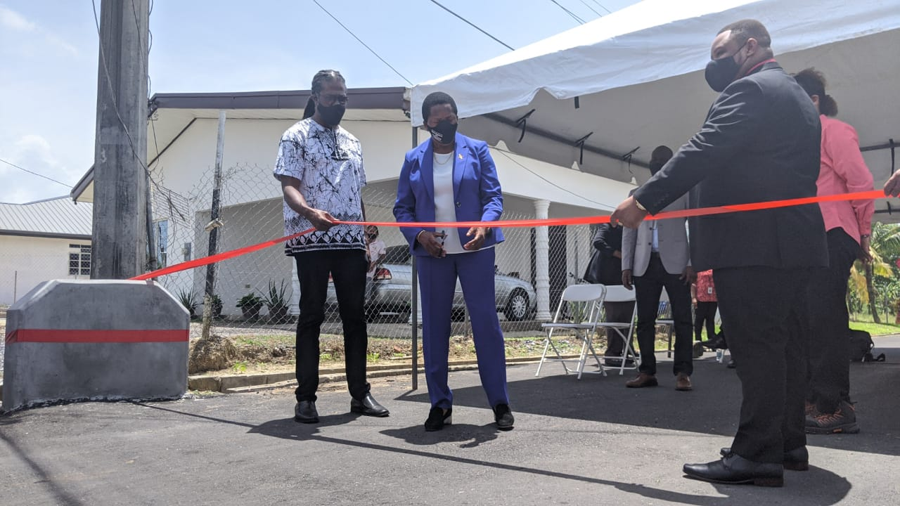 Ministers of Housing, Adrian Leonce and Penelope Beckles-Robinson (substantive) cut a ribbon with Toco/Sangre Grande MP, Roger Munroe to celebrate development in Bois Bande, Sangre Grande.