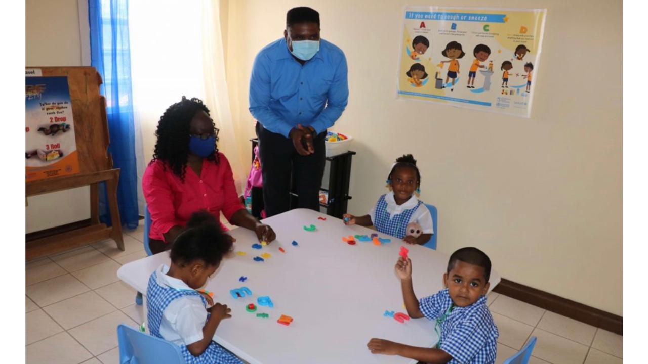 Troy Liburd, Junior Minister of Education in the Nevis Island Administration interacts with staff and students during a tour of the Farms Estate extension of the Charlestown Preschool on September 07, 2020. Photo courtesy Nevis Island Administration.