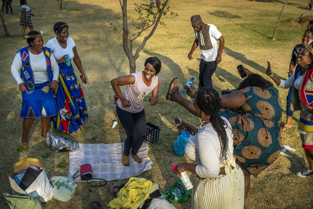 Folks celebrate South Africa's Heritage Day by dancing at Zoo Lake Park in Johannesburg. Celebrations all around Africa have been amplified by the Master KG track Jerusalema. (AP Photo/Jerome Delay)