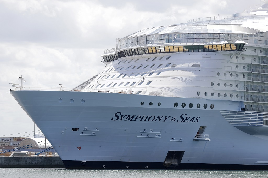 FILE - The Symphony of the Seas cruise ship is shown docked at PortMiami, in a Wednesday, May 20, 2020, file photo, in Miami.  (AP Photo/Wilfredo Lee, File)