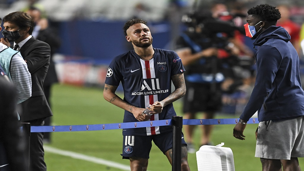 PSG's Neymar stands on the pitch disappointed after losing the Champions League final against Bayern Munich at the Luz stadium in Lisbon, Portugal, Sunday, Aug. 23, 2020. (David Ramos/Pool via AP).