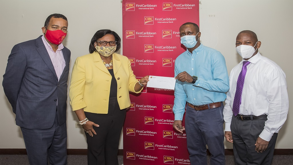 Jerome Griffiths (2nd left), Head of Human Resources at CIBC FirstCaribbean presents Dr Matthew Wanliss, Senior Registrar, General Surgery at the University Hospital of the West Indies (UHWI) with a cheque toward the purchase of protective gear for surgery residents.  Sharing the presentation are Nigel Holness (left), Managing Director of the bank and Professor Joseph Plummer, Head, Department of Surgery, Radiology & Anaesthesia & IC, Mona Institute of Medical Sciences, UHWI
