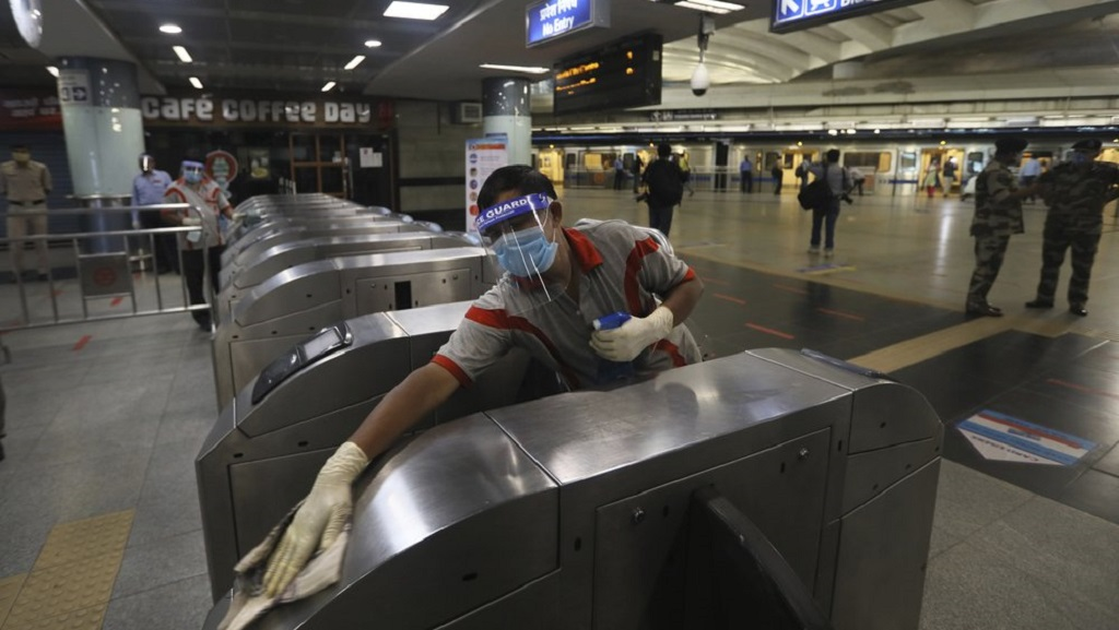 A workers sanitizes a metro station in New Delhi, India, Thursday, Sept. 3, 2020. Delhi Metro will open its services in a phased manner from September 7, even as India has been reporting the highest single-day caseload in the world every day for more than three weeks and is the third worst-hit country behind the United States and Brazil. (AP Photo/Manish Swarup)