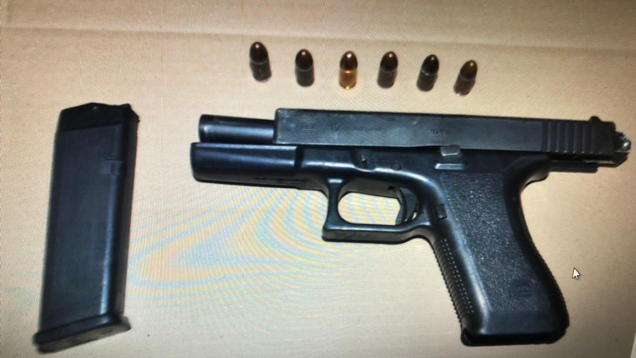 A firearm and ammunition seized following a police involved shooting.