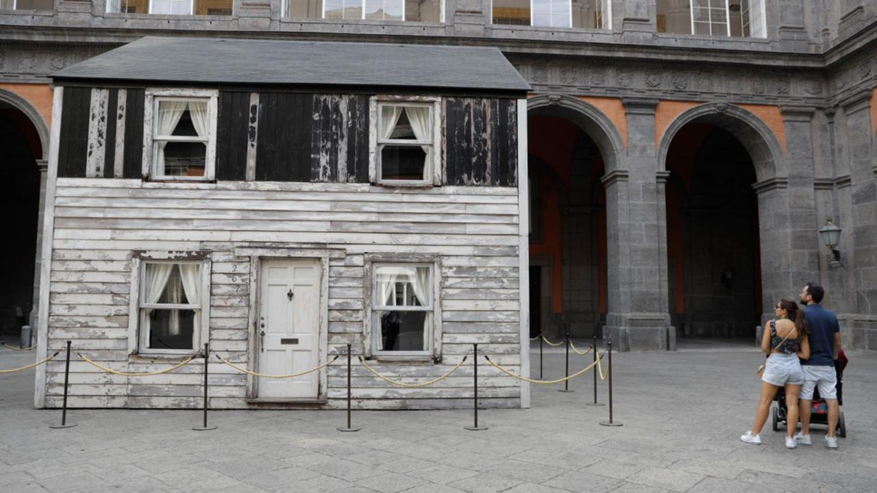 The house of U.S. civil rights campaigner Rosa Parks, rebuilt by artist Ryan Mendoza, is on display in the courtyard of an 18th century Royal Palace, in Naples, Italy, Tuesday, Sept. 15, 2020. It's the latest stop for the house in a years-long saga that began when Parks' niece saved the tiny two-story home from demolition in Detroit after the 2008 financial crisis. (AP Photo/Gregorio Borgia)