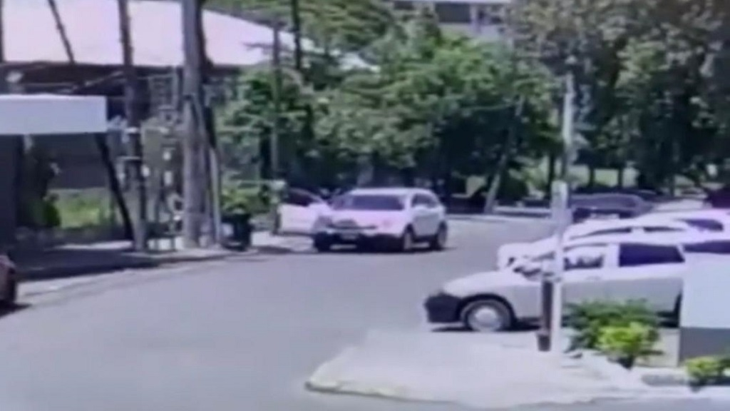 A screengrab from a video recording of the shooting of a businessman in New Kingston by gunmen on Saturday.