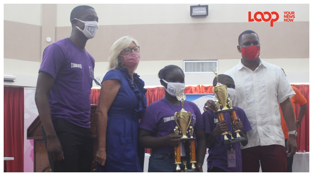 Top girl and top boy of the Project S.O.F.T programme, Marisa Lowe and Quinlan Parris, flanked by Team Leader of Purple Scorpions( L) and Trustee of the Sandy Lane Charitable Trust Pippa Challis and Minister Wilfred Abrahams (R)