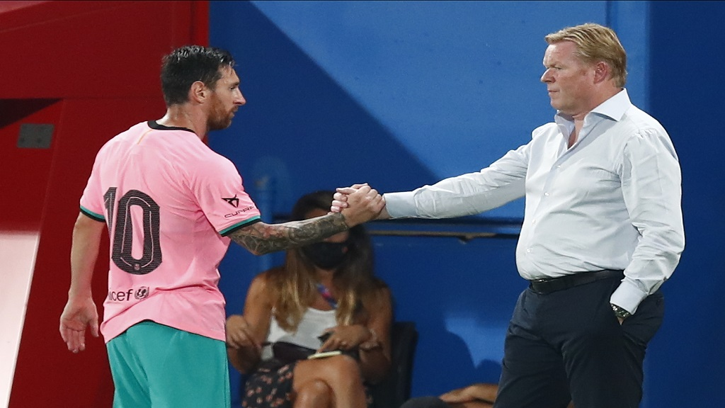 Barcelona's Lionel Messi, left, shakes hands with Barcelona's coach Ronald Koeman as he is substituted during the pre-season friendly football match against Girona at the Johan Cruyff Stadium in Barcelona, Spain, Wednesday, Sept. 16, 2020. (AP Photo/Joan Monfort).