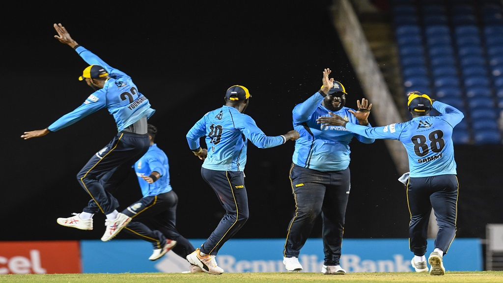 Rahkeem Cornwall (second right) of St Lucia Zouks celebrates with his teammates the dismissal of Guyana Amazon Warriors' Imran Tahir during the second semi-final of the Hero Caribbean Premier League, at the Brian Lara Cricket Academy in Tarouba, Trinidad and Tobago,  on Tuesday, September 8, 2020. (Photo by Randy Brooks - CPL T20/CPL T20 via Getty Images).