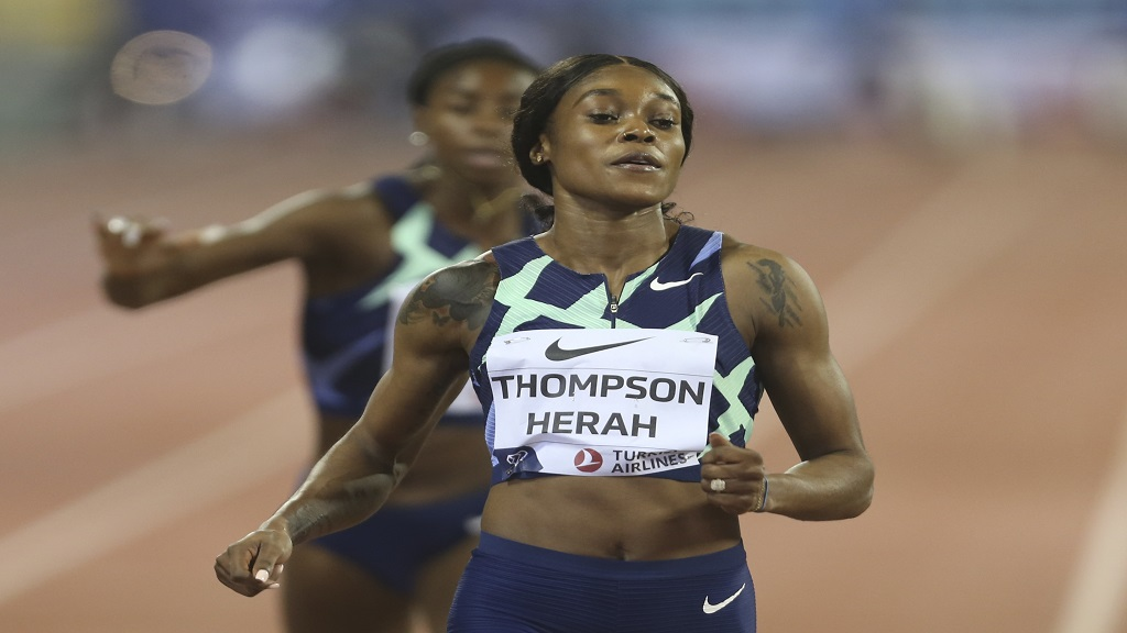 Jamaica's Elaine Thompson-Herah, wins the Women's 100m at the IAAF Diamond League in Doha, Qatar, Friday, Sept. 25, 2020. (AP Photo/Hussein Sayed).