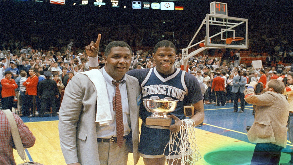 In this March 9, 1985, file photo, Georgetown NCAA college basketball head coach John Thompson poses with player Patrick Ewing after Georgetown defeated St John's in the Big East Championship in New York. (AP Photo/File)
