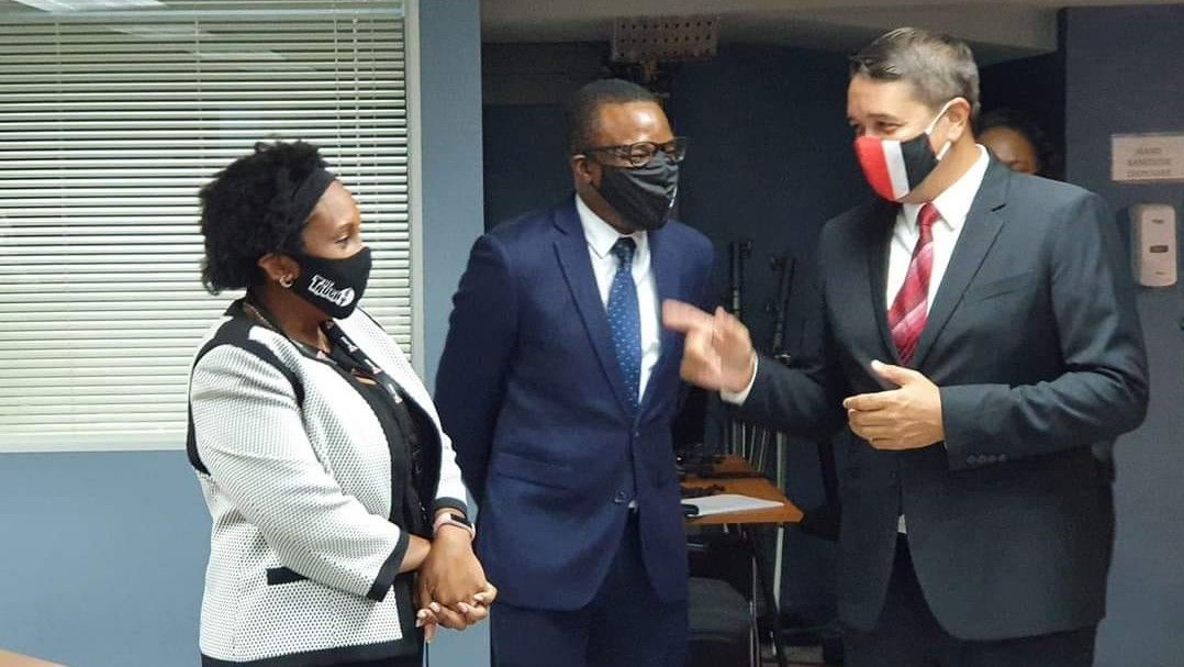 Communications Minister, Symon de Nobriga (right) shares a moment with TTT Executive Producer, Stacy Ann Providence (left) and CEO David Roberts (centre).