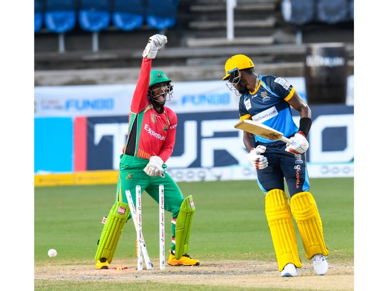 Barbados Tridents batsman Justin Greaves (right) is bowled in front of the Guyana Amazon Warriors wicketkeeper Nicholas Pooran during Match 26 of the 2020 Hero Caribbean Premier League on Thursday 3rd September 2020 at the Brian Lara Cricket Academy. (Photo by Randy Brooks - CPLT20/Getty Images)