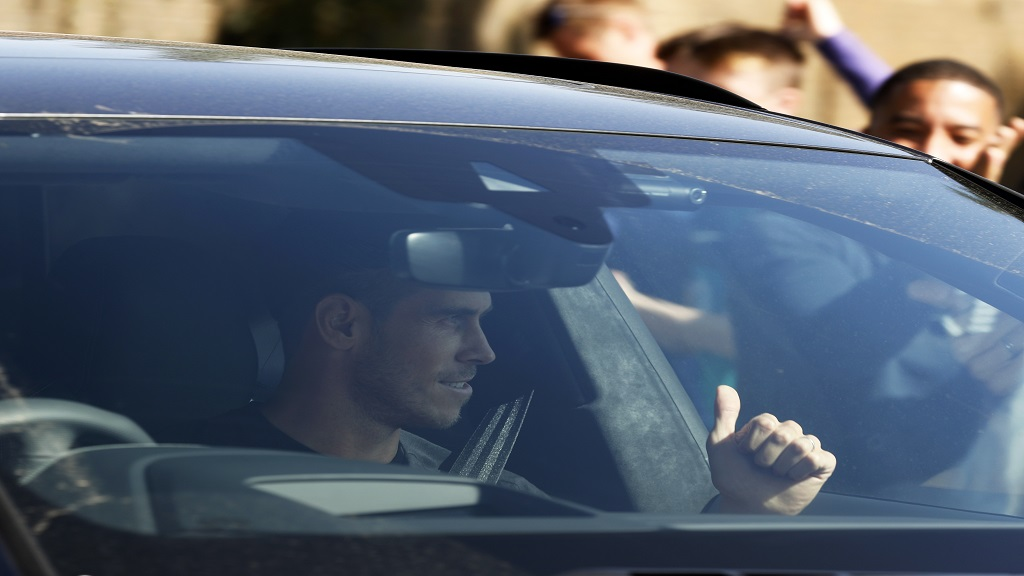 Gareth Bale gestures to fans as he arrives at the training ground of Tottenham Hotspur in London, Friday Sept. 18, 2020. Real Madrid winger Gareth Bale is in London to complete his return to Tottenham. (AP Photo/Frank Augstein).