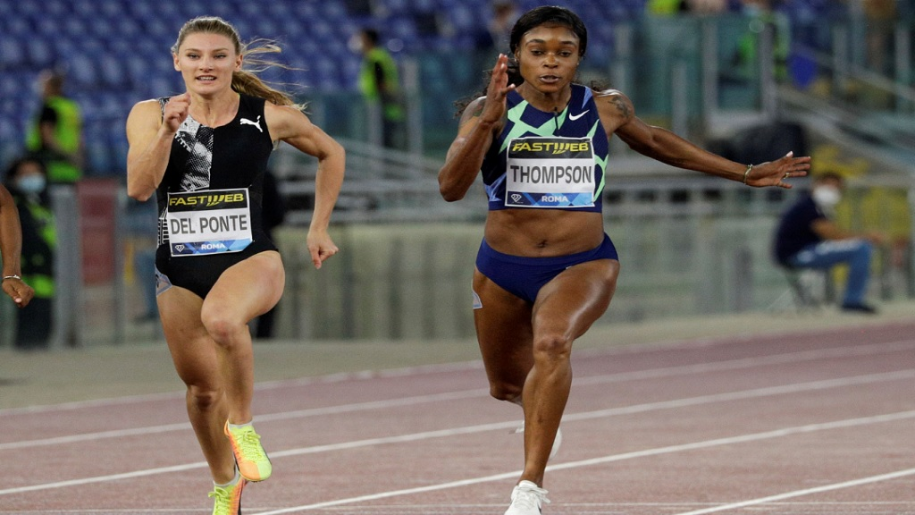 Jamaica's Elaine Thompson-Herah, right, wins in a world leading10.85 seconds the women's 100m competition at the Golden Gala Pietro Mennea IAAF Diamond League athletics meet in Rome, Thursday, Sept. 17, 2020. At left fourth placed Ajla Del Ponte of Switzerland. (AP Photo/Gregorio Borgia).