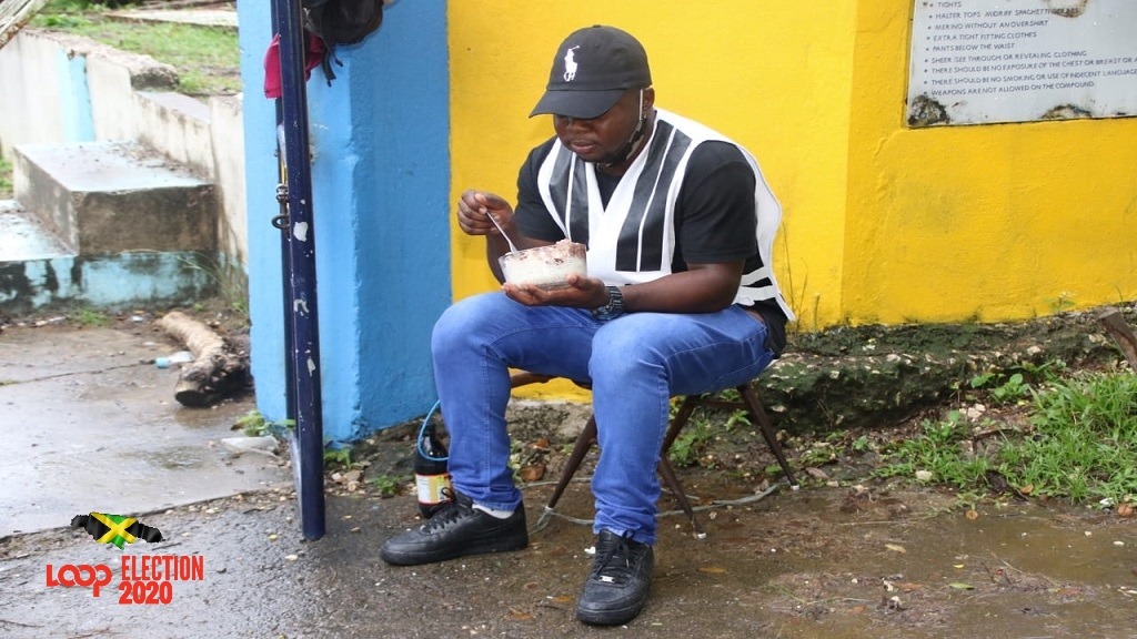The lone 'one-day' policeman at a polling station in Crooked River, Clarendon on Election Day.