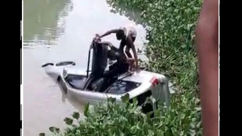 A screengrab from a video of a rescue attempt after a female senior citizen's car  crashed in the Bog Walk Gorge in St Catherine on Tuesday and ended up in the Rio Cobre.