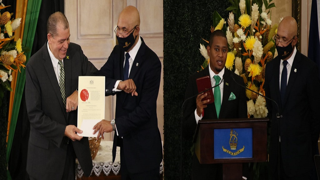 From left to right Audley Shaw being sworn in as Minister of Industry, Investment and Commerce and Floyd Green being sworn in as Minister of Agriculture and Fisheries by Governor General Sir Patrick Allen.