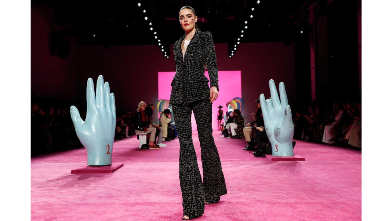 The Christian Siriano collection is modeled during Fashion Week in New York on Feb. 6, 2020. With no celebs in the front row, no paparazzi chasing models down the streets, no stiletto-heeled crowds and no live shows at all, is there even a point to doing Fashion Week in 2020? Well, yes, say organizers: It's about business. And jobs. And survival. (AP Photo/John Minchillo, File)