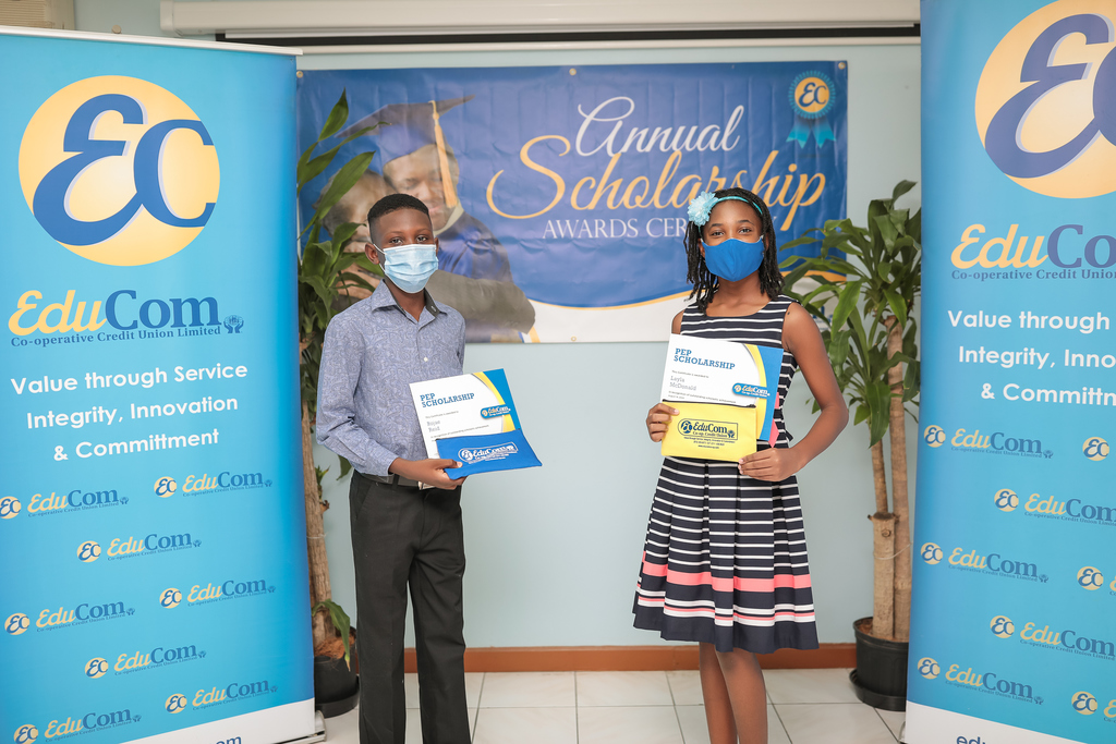 PEP awardees Rojae​ Reid (l) and Layla McDonald (r) share lens time at the presentation ceremony last month at the EduCom office in Kingston.