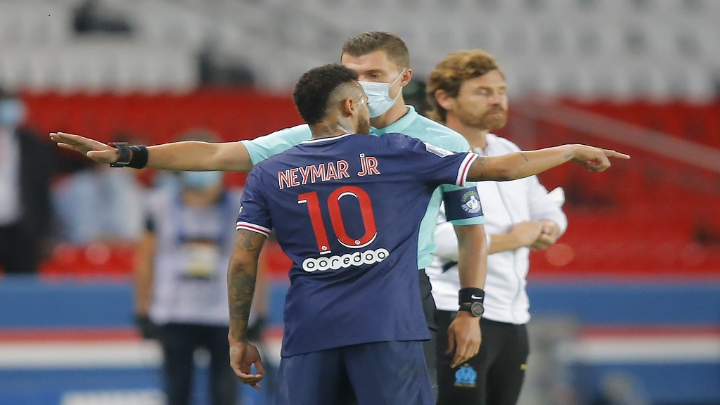 PSG's Neymar argues with the fourth official as he leaves the pitch after getting a red card during the French League One football match against Marseille at the Parc des Princes in Paris, France, Sunday, Sept.13, 2020. (AP Photo/Michel Euler).