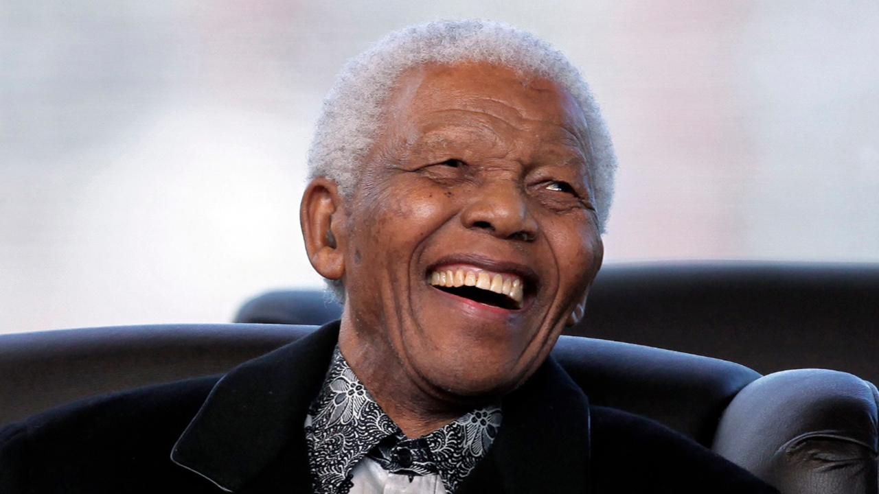 In this, May 9, 2009 file photo, South Africa's former President Nelson Mandela attends the inauguration ceremony of President Jacob Zuma in Pretoria, South Africa. According to an account in a book written by Trump's former personal lawyer Michael Cohen, published Tuesday September 8, 2020, US President Donald Trump made crude, disparaging remarks about Mandela, that has drawn an angry response from South Africa's ruling African National Congress party and others. (AP Photo/Themba Hadebe, File)