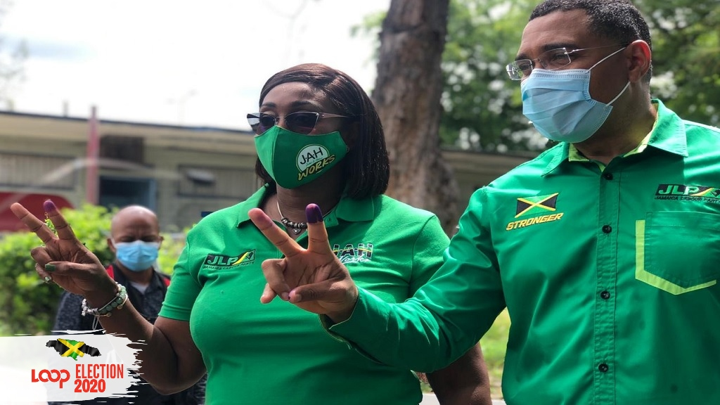 Prime Minister Andrew Holness and his wife Juliet Holness, of the ruling Jamaica Labour Party, show their fingers after voting in Thursday's general elections.