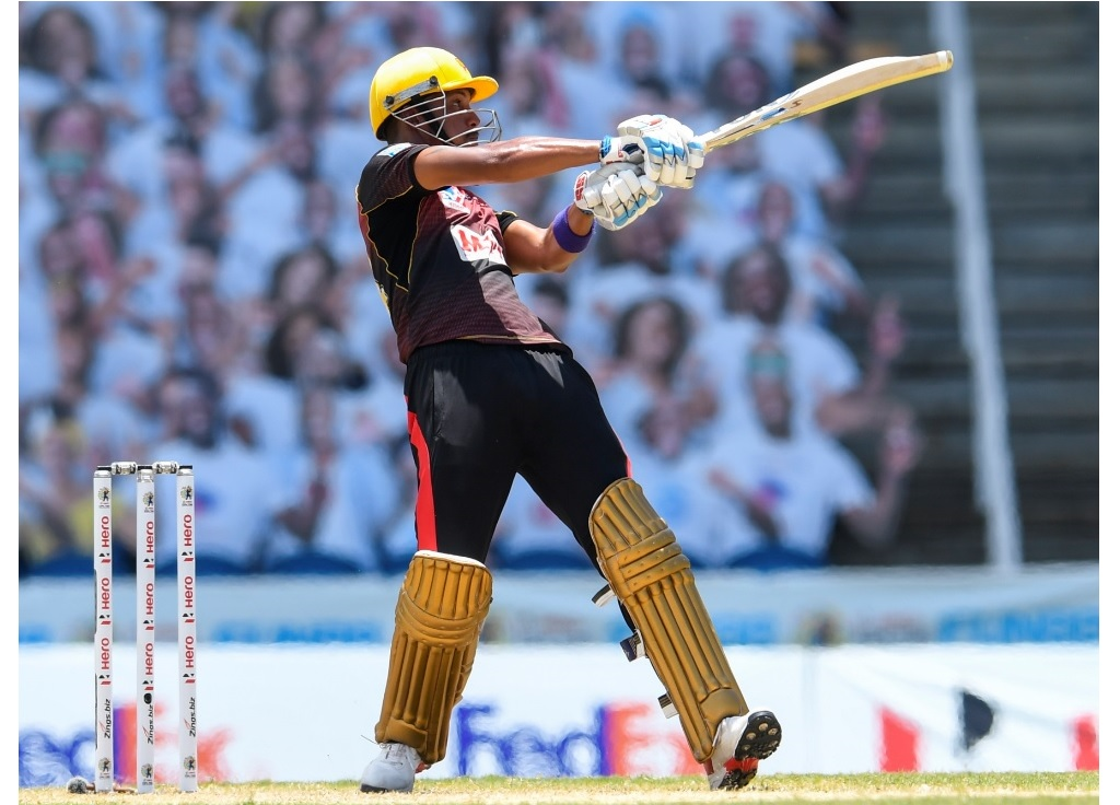 Lendl Simmons of Trinbago Knight Riders hits a six during the first semi-final of the 2020 Hero Caribbean Premier League against Jamaica Tallawahs, at the Brian Lara Cricket Academy, in Tarouba, Trinidad and Tobago, on Tuesday, September 8.  (Photo by Randy Brooks - CPL T20/CPL T20 via Getty Images).