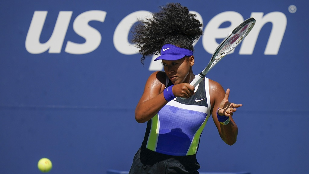 Naomi Osaka, of Japan, returns a shot to Marta Kostyuk, of the Ukraine, during the third round of the US Open tennis championships, Friday, Sept. 4, 2020, in New York. (AP Photo/Seth Wenig).