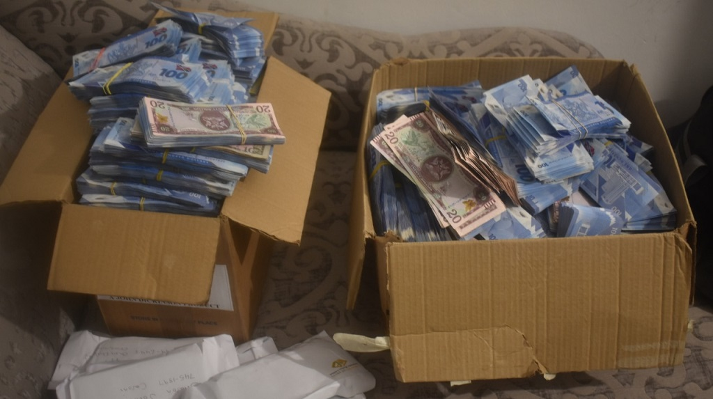 Cash seized by the police Tuesday from a pyramid   scheme. A soldier was among nine people arrested. (Photos: The Trinidad and Tobago Police Service).