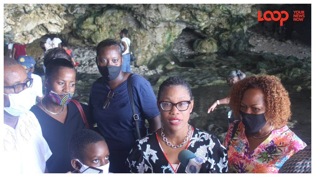 Minister of Tourism and International Transport, Senator Lisa Cummins on tour of the Animal Flower Cave with BTMI's Marsha Alleyne, Minister Peter Phillips, campers and industry workers