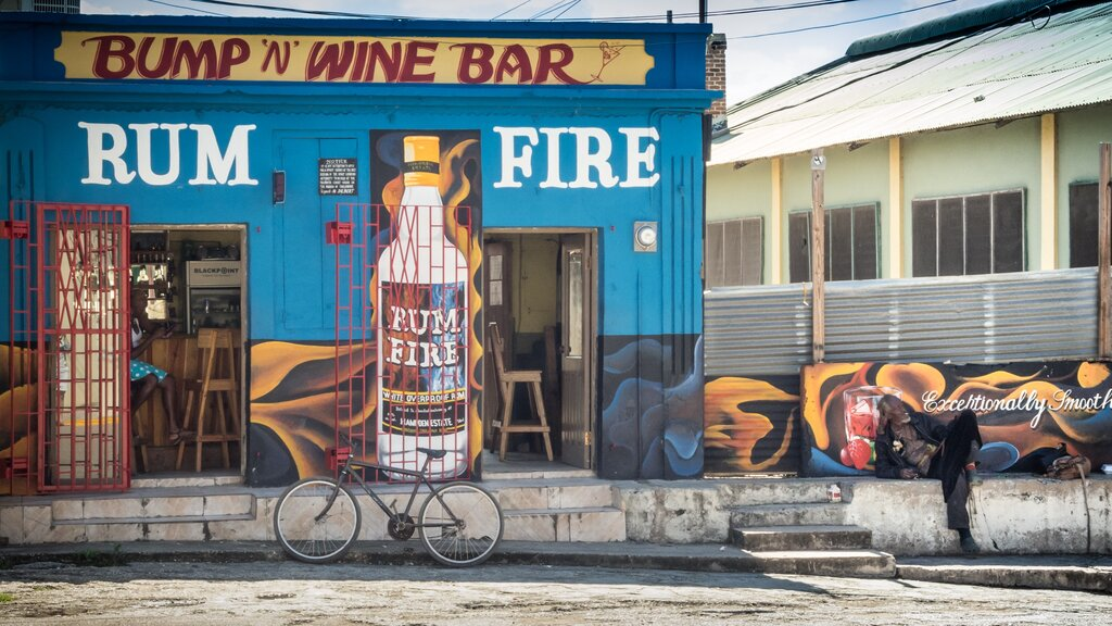 Falmouth, Jamaica – February 12, 2015: View of a local bar downtown near the Falmouth Cruise Port, along with locals, a bike and buildings in Falmouth, Jamaica. Photo iStock