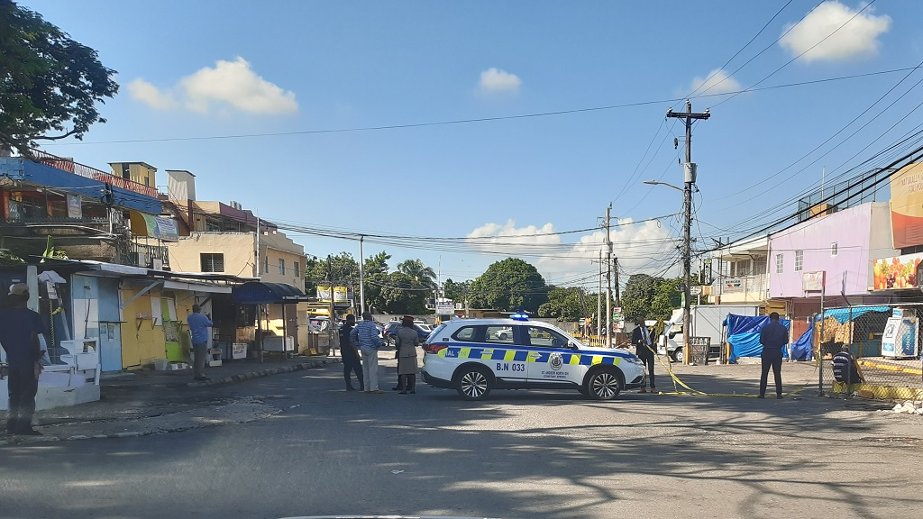Police officers at the crime scene on Chancery Street after a man was shot dead there on Tuesday morning.