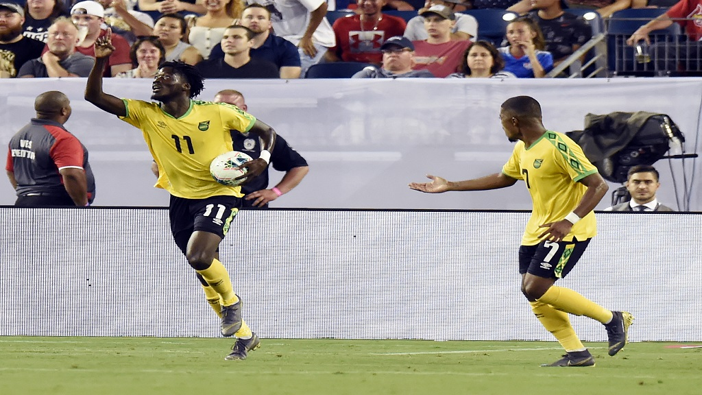 Jamaica forward Shamar Nicholson (11) celebrates after scoring a goal against the United States during the second half of their Concacaf Gold Cup semifinal football match Wednesday, July 3, 2019, in Nashville, Tenn. The United States won 3-1.