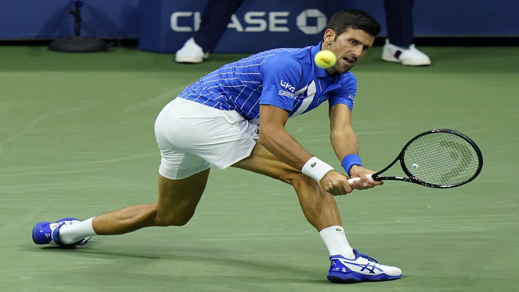 Novak Djokovic, of Serbia, returns a shot to Jan-Lennard Struff, of Germany, during the third round of the U.S. Open tennis championships, Friday, Sept. 4, 2020, in New York. (AP Photo/Frank Franklin II).