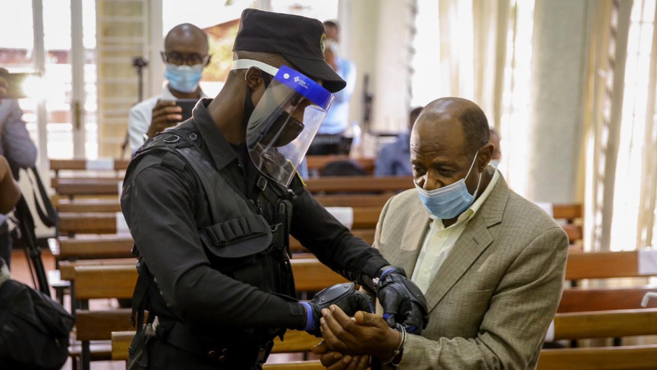 "A policeman handcuffs Paul Rusesabagina, right, whose story inspired the film ""Hotel Rwanda"", before leading him out of the Kicukiro Primary Court in the capital Kigali, Rwanda Monday, Sept. 14, 2020."