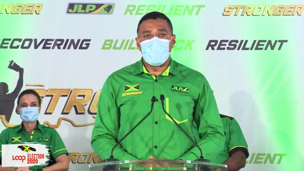 Prime Minister Andrew Holness addresses journalists after his Jamaica Labour party secured a massive landslide victory at the polls on Thursday.